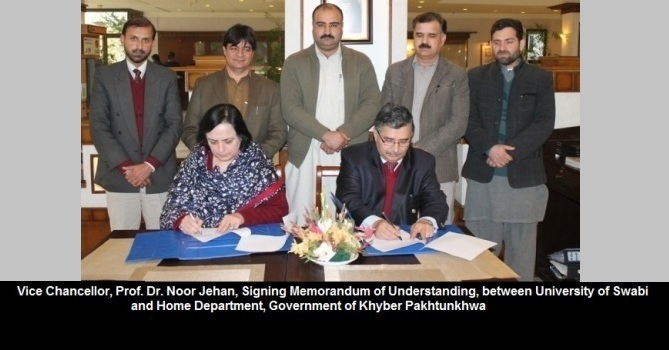 Vice Chancellor, Prof. Dr. Noor Jehan, Signing Memorandum of Understanding, between University of Swabi and Home Department, Government of Khyber Pakhtunkhwa