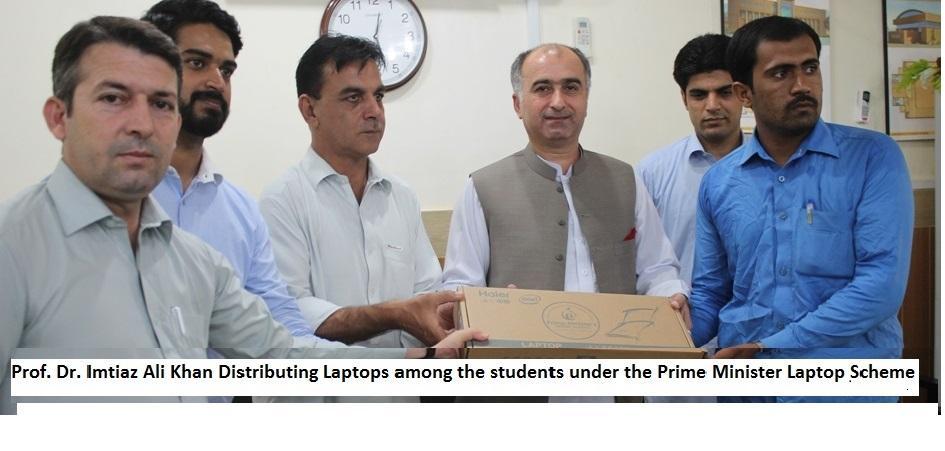 Prof. Dr. Imtiaz Ali Khan Distributing Laptops among the students under the Prime Minister Laptop Scheme